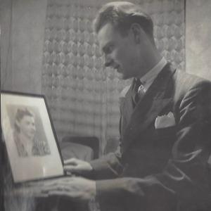 Mac looking at a photo of Gran